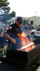 Jerome Fire lieutenant James Paisano mans the BBZ grill at the town picnic