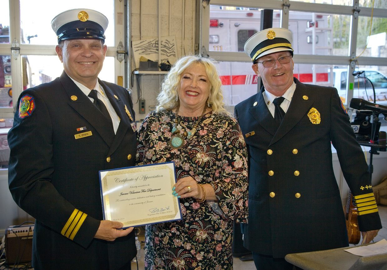 an aide to congressman Gosar presents a certificate to the chief and assistant chief for jerome fire