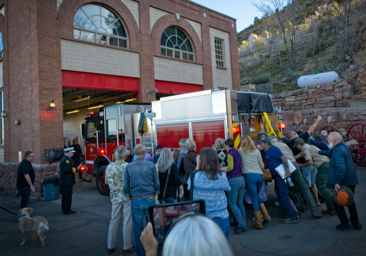 the crowd begins pushing in the new engine 111